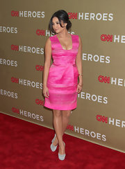 Shay Mitchell emphasized the silver streaks in her hot pink dress with a pair of dove gray suede pumps.