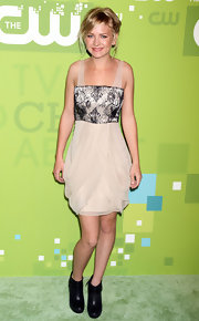 Britt Robertson's ultra-feminine cocktail dress at the CW Network 2011 Upfront event featured a lace-overlay bodice and a draped skirt.
