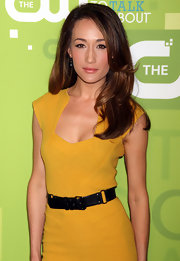 Maggie Q added flair to her mustard sheath with a stylish black leather belt when she attended CW Network's 2011 Upfront event.