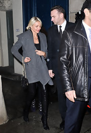 Cameron Diaz enveloped herself in a modern charcoal coat at the Givenchy show.