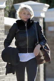 Cameron Diaz had an aviation vibe in London in a leather bomber jacket.