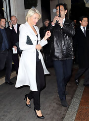 Cameron Diaz added impact to her sleek black outfit with a white full-skirted coat.