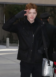 Cameron Monaghan gave an interview to TMZ wearing gray fingerless gloves.