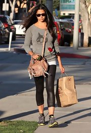Camila Alves paired her casual look with a Crinkle Lamb Leather Crossbody bag with playful fringe.