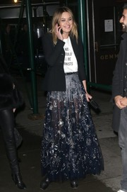 Camille Rowe championed girl power with this 'We Should All Be Feminists' T-shirt by Dior while out in New York City.