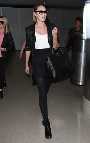 Candice Swanepoel looked rocker glam in this two-tone day dress, moto jacket, and flat leather boots.