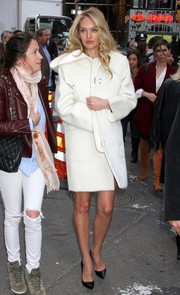 Candice Swanepoel kept warm with a stylish white coat as she headed to the 'Good Morning America' studios.