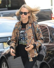 Cara Delevingne accessorized with a pair of classic Ray-Ban wayfarers for a day out in New York City.