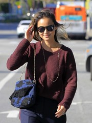 Jamie Chung stepped out in West Hollywood carrying a knit bag with a gold chain strap.