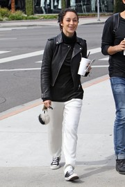 Cara Santana teamed her jacket and turtleneck with white silk pants.