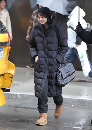 Carey kept comfy and warm in sheepskin boots.