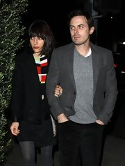 Casey Affleck kept his Valentine's dinner look simple with a gray blazer and gray sweater.