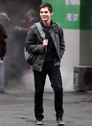 Logan Lerman was casual but dapper in his monochromatic ensemble, consisting of black jeans, a shirt, and a gray jacket.