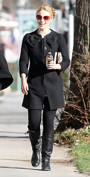 Dianna Agron takes a break from filming and shows off her black leather flat boots.
