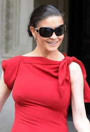 Catherine wore super dark oversize shades with gold accents.