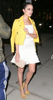 Olivia Culpo added an edgy touch with a yellow leather biker jacket by Victoria Beckham.