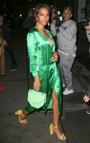 Solange Knowles headed to the Stuart Weitzman dinner looking bright in a green silk wrap dress.