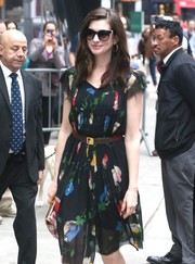 Anne Hathaway headed to 'Good Morning America' wearing butterfly sunnies and a lovely floral dress.