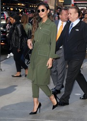 Shay Mitchell was tough-glam in a military-green trenchcoat and matching pants while headed to 'Good Morning America.'