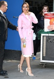 Troian Bellisario left 'Good Morning America' looking sweet in a bubblegum-pink coat.