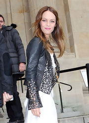 Vanessa Paradis channeled a rock star at the Chanel show in a laser cut leather jacket, layered over a romantic white gown.