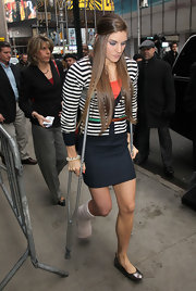 Anna Watson stood out in a striped cardigan with a green belt.
