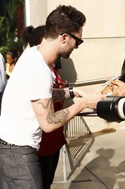 Maroon 5 frontman Adam Levine has a tiger tattooed on his left arm.