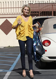 Chelsea Kane was a ray of sunshine in a gathered yellow blouse.