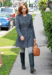 Jessica Alba carried a structured brown Aurore bag. The posh tote was a ladylike addition to her military inspired pea coat.