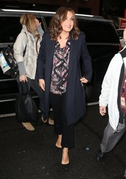Mariska Hargitay teamed her coat with cropped black slacks and a print blouse.