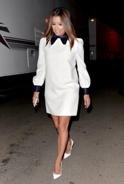 Eva Longoria attended a Hilary Clinton event wearing a cute white mini dress with a navy satin collar and cuffs.