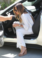 Nicole Scherzinger arrived for the Day of Indulgence Summer Party wearing strappy nude wedges with white separates.