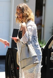Leona Lewis arrived for the Day of Indulgence Summer Party carrying a chain-embellished bucket bag.