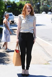 Bryce Dallas Howard was casual yet cute in a ruffle-sleeve, tie-neck blouse at the Day of Indulgence Summer Party.