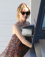 Leslie Mann kept the summer rays out with a pair of tortoiseshell wayfarers while attending the Day of Indulgence party.