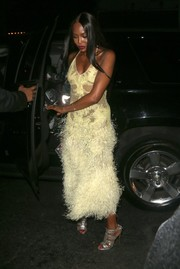 Naomi Campbell was a vision in a pale-yellow Givenchy halter dress boasting a marabou feather-festooned skirt while headed to Rihanna's VMA after-party.
