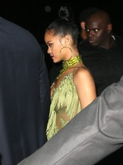 Rihanna accessorized with a huge pair of green crystal hoop earrings by Kerin Rose Gold for her VMA after-party.