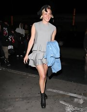 Chloe Sevigny opted for a sleeveless frock with gray ruffles on the skirt for her look at Stones Fest in LA.