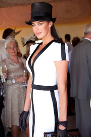 Megan wears a decorative 'top hat' that ties in with her black and white outfit.