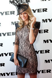 Jennifer's leather clutch is a a great contrast to her lace dress.