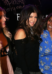 Fergie's chocolate brown locks are layered and loosely curled. This look has a very effortlessly sexy appeal.