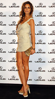 The model showed off her mile long legs in a super short mini dress and a pair of nearly nude, platform, slingback sandals.