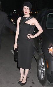 Melissa George wore a surprising accessory with her fashion-forward little black dress.