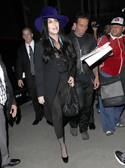 Cher watched 'The Book of Mormon' wearing a tight-fitting outfit, which she toned down with a black wool coat.