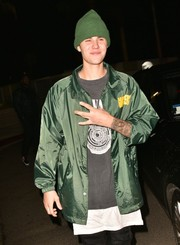 Justin Bieber paired a green Cloney rain jacket with a graphic tee for Kendall Jenner's 20th birthday party.