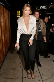 Gigi Hadid polished off her look with a pair of embellished multi-strap sandals by Giuseppe Zanotti.