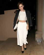 Lily Collins looked oh-so-cool in a patterned white crop-top and a black blazer draped over her shoulders as she left Bouchon Bistro.