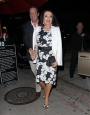 Joan Collins kept it ladylike in a monochrome floral frock during a dinner date at Craig's Restaurant.