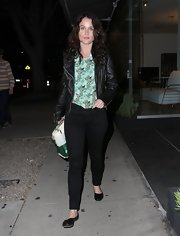 Robin Tunney mixed masculine and feminine when she paired an edgy leather jacket with a girlie floral print top.