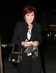 Sharon Osbourne dined out at Madeo Restaurant carrying a chain-strapped leather shoulder bag.